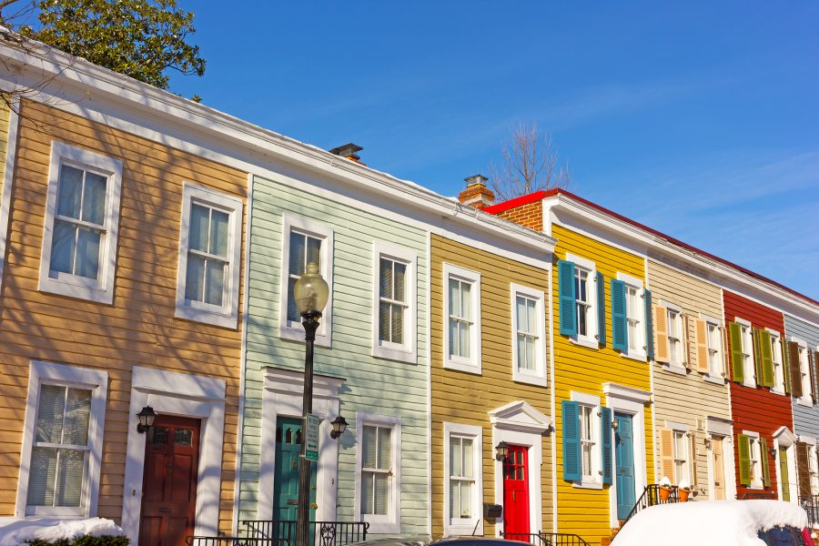 Row townhouses in Georgetown on a bright morning.